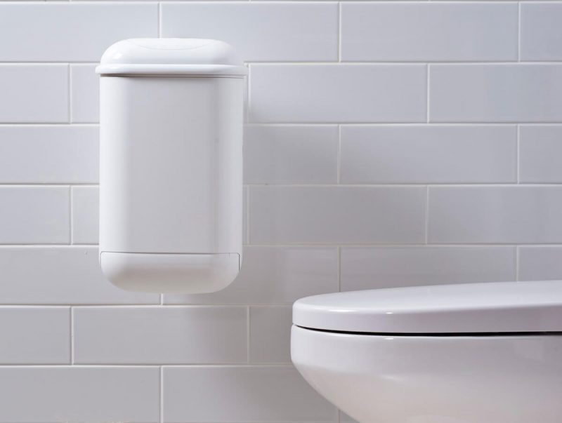 A white Pod Petite Auto unit on a white tiled wall