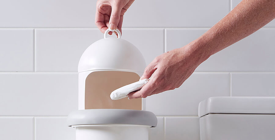 A person disposing sanitary waste into Pod Classic Manual unit