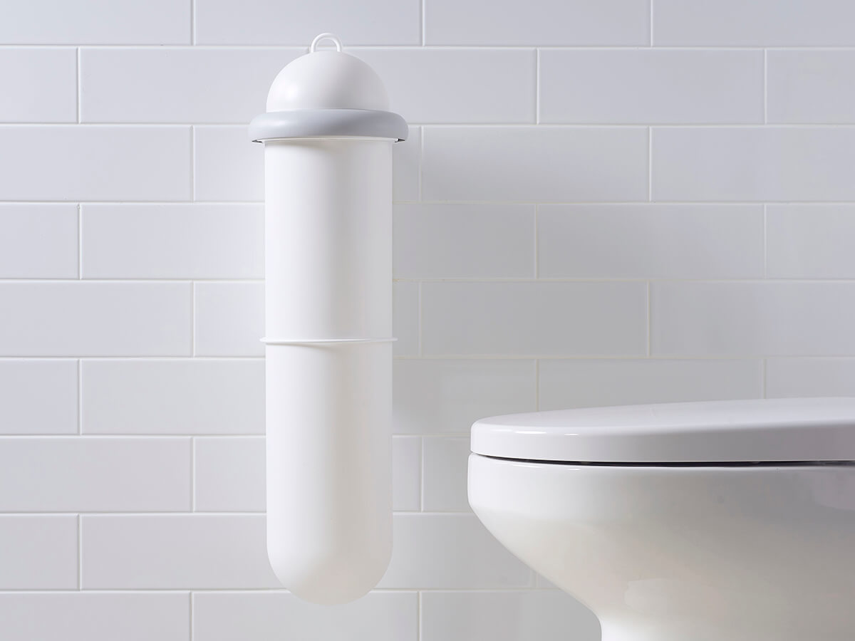Pod Classic Manual white sanitary unit installed on white tiled wall