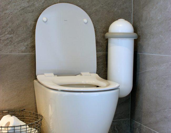 The white Pod Classic Mini placed next to a toilet