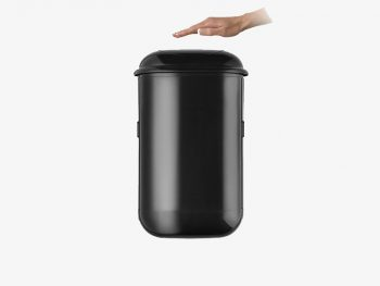 The black Pod Petite Auto with a hand over touch-free sensor