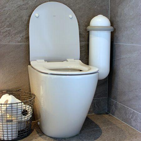 A white Pod Classic Mini Auto beside a toilet