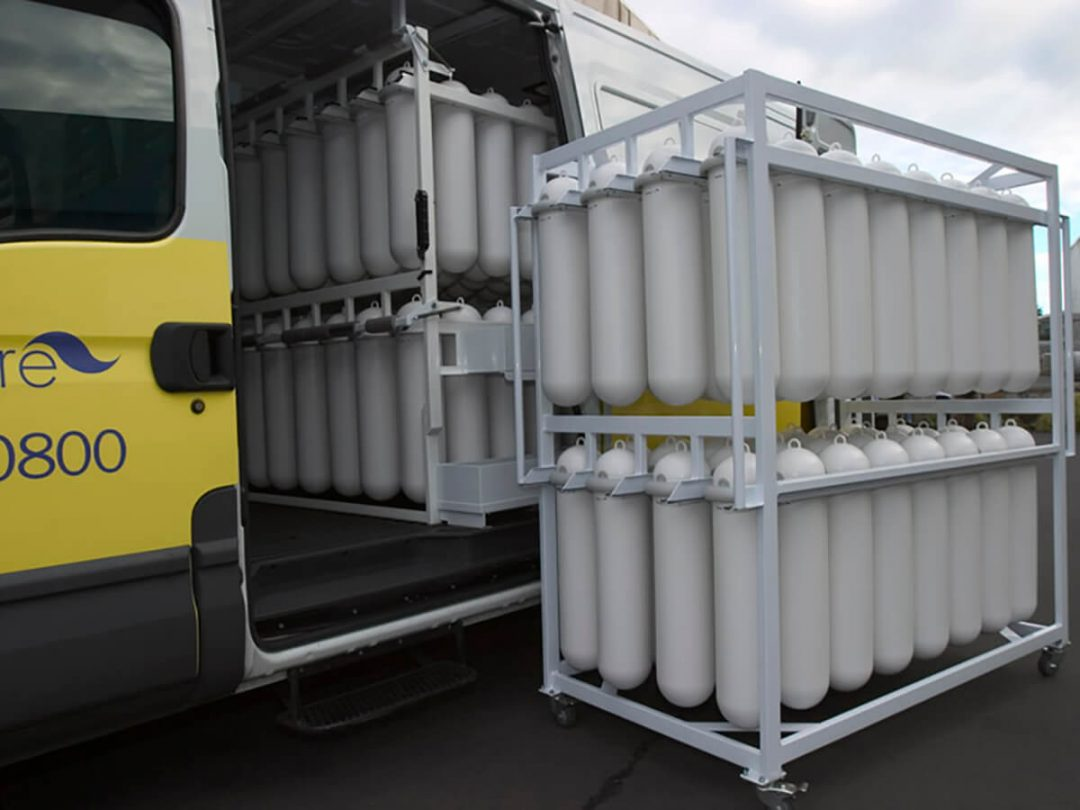 A hygiene service vehicle with SaniPod racking and a service trolley