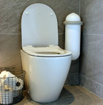 The Pod Classic Mini placed next to a toilet