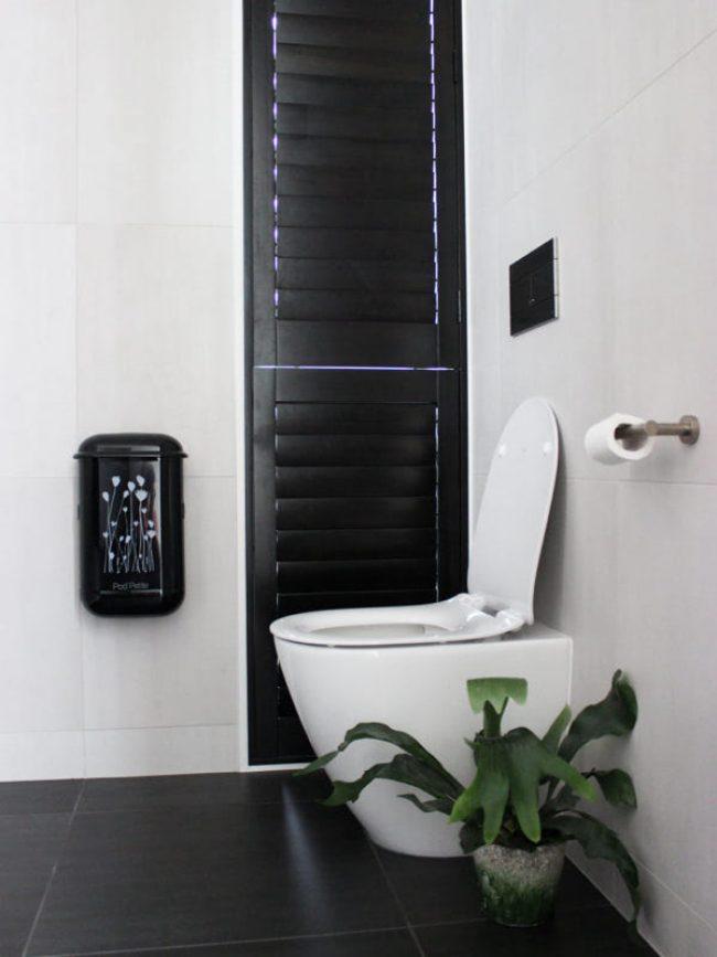 The black Pod Petite sanitary disposal unit with a Pod Wrap decal