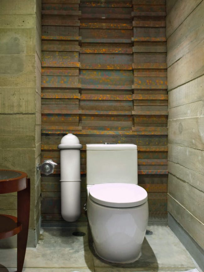 The Pod Classic sanitary pad disposal system in a tiled bathroon